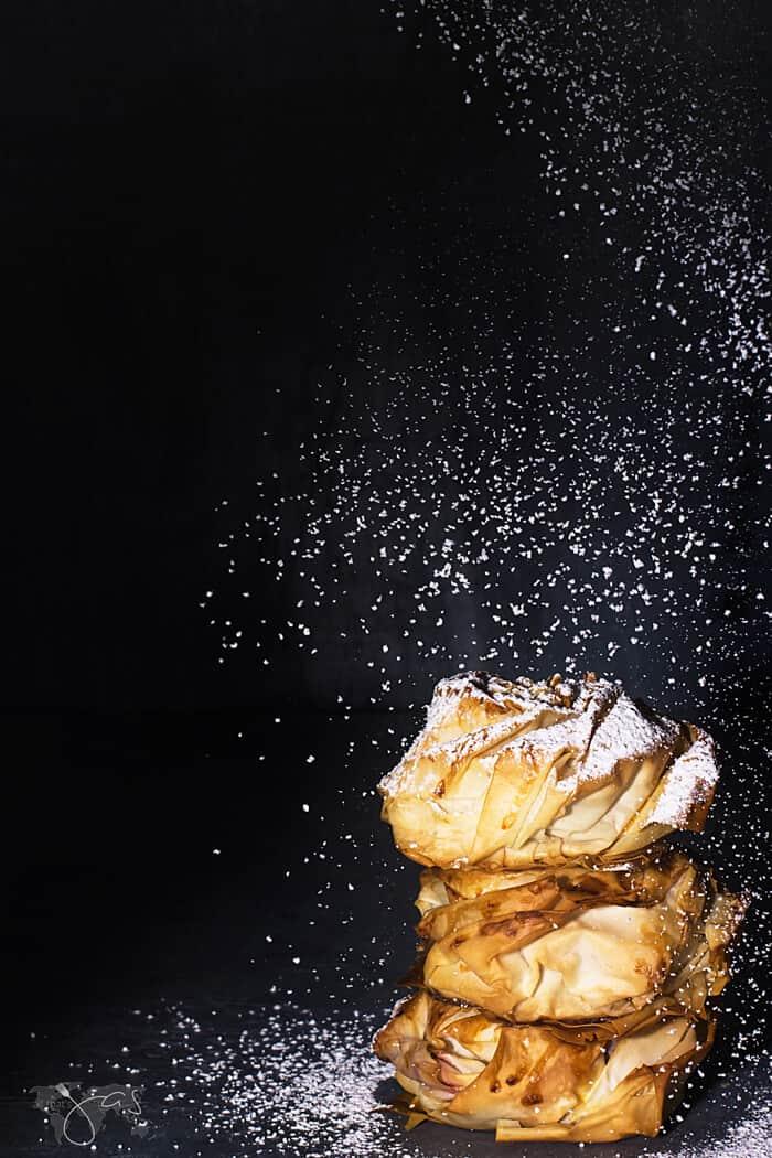 Dusting the PB&J fillo doughnuts - fillonuts - with powdered sugar