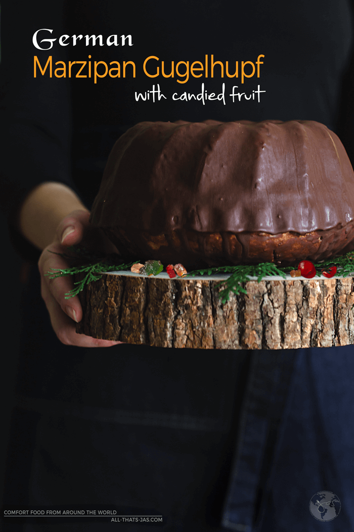 If you're afan of old-world easy and delicious desserts, you will love this German bundt cake with almond paste, aka marzipan Gugelhupf! The candied fruit adds the festive color and the chocolate glaze the richness to this amazing cake. | allthatsjas.com | #baking #holidayrecipe #cake #recipes #bundtcake #gugelhupf #german #Christmas #marzipan #almondpaste #candiedfruit #chocolateglaze #recipeofthemonth #fromscratch #allthatsjas #kuglof #kugelhopf