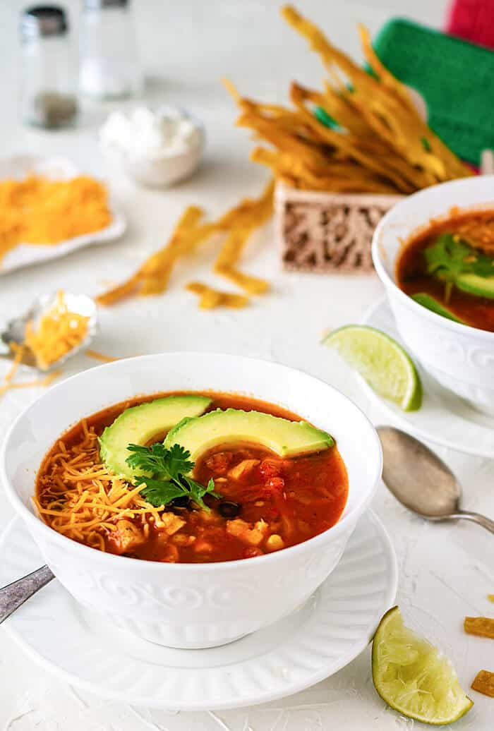 Quick and easy Mexican chicken soup with baked tortilla strips.