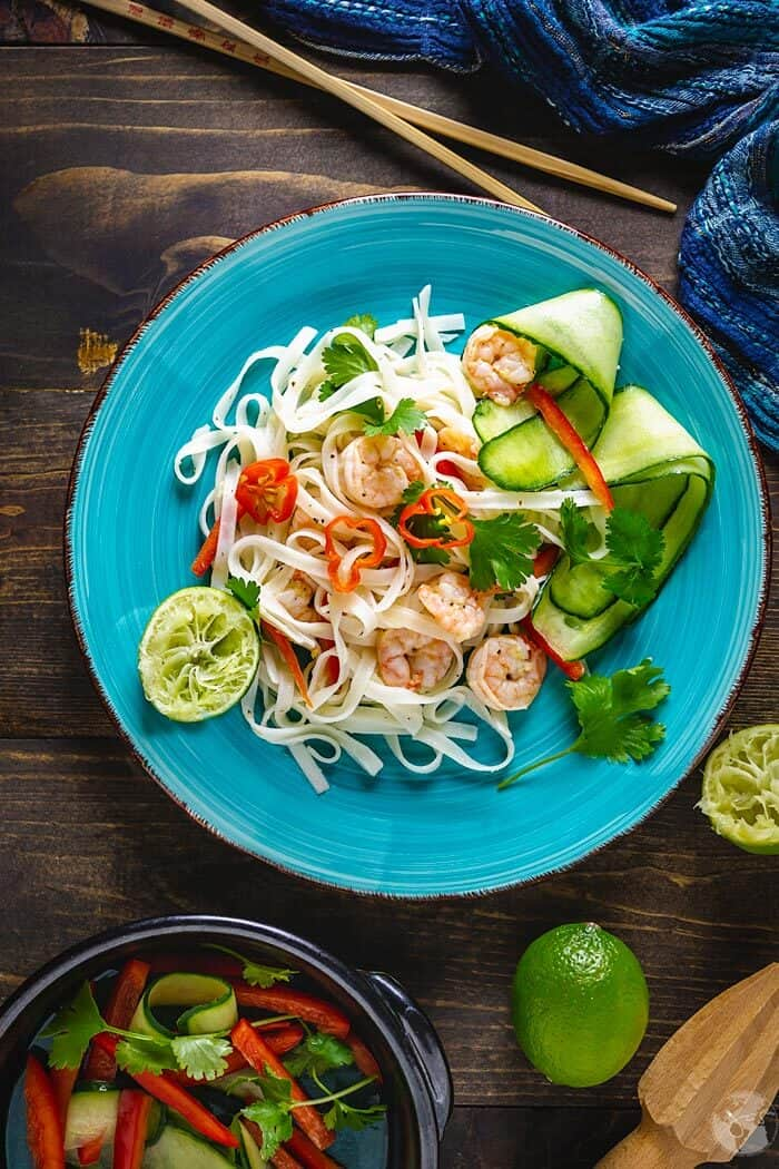 A plate of salad with Thai rice linguine, fresh vegetables and spicy shrimp