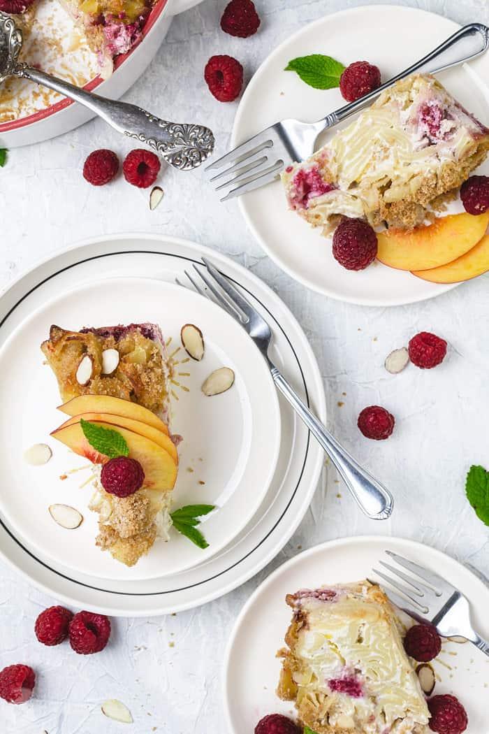 Slices of melba kugel served on white plates