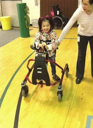 Enji uses a gait trainer
