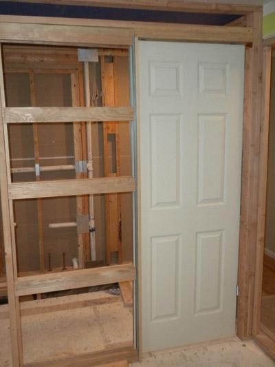 centennialbathroompocketdoor  All About Bathrooms