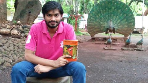 Niranjan Navalgund with his book The Lively Library & an Unlikely Romance!