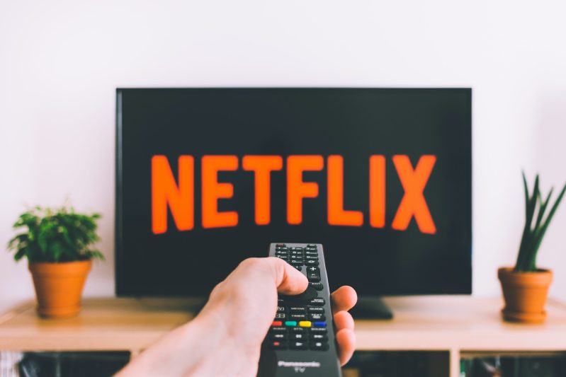 closeup photo of person holding panasonic remote control in 987586 scaled - I LOVE NETFLIX TAG