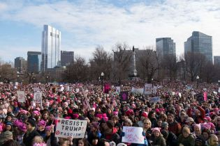 Thousands of people fill Boston Common during a Women's March Saturday Jan. 21, 2017 in Boston. The march is being held in solidarity with similar events taking place in Washington and around the nation. IMAGE: JOHN TLUMACKI/THE BOSTON GLOBE VIA AP PHOTO