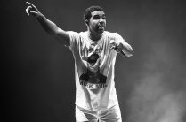 CAMDEN, NJ - AUGUST 21: (EDITORS NOTE: Image has been converted to black and white.) Rapper Drake performs Drake Vs Lil Wayne Tour at the Susquehanna Bank Center on August 21, 2014 in Camden, New Jersey. (Photo by Gilbert Carrasquillo/Getty Images)