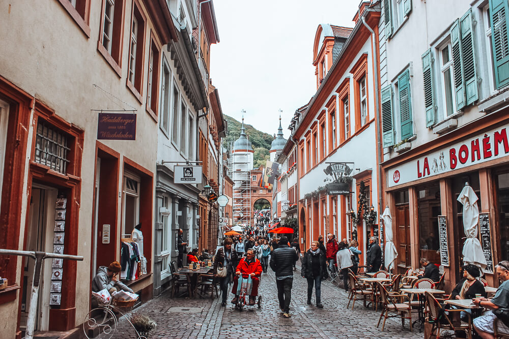 Street filled with people in the old town of Heidelberg Germany