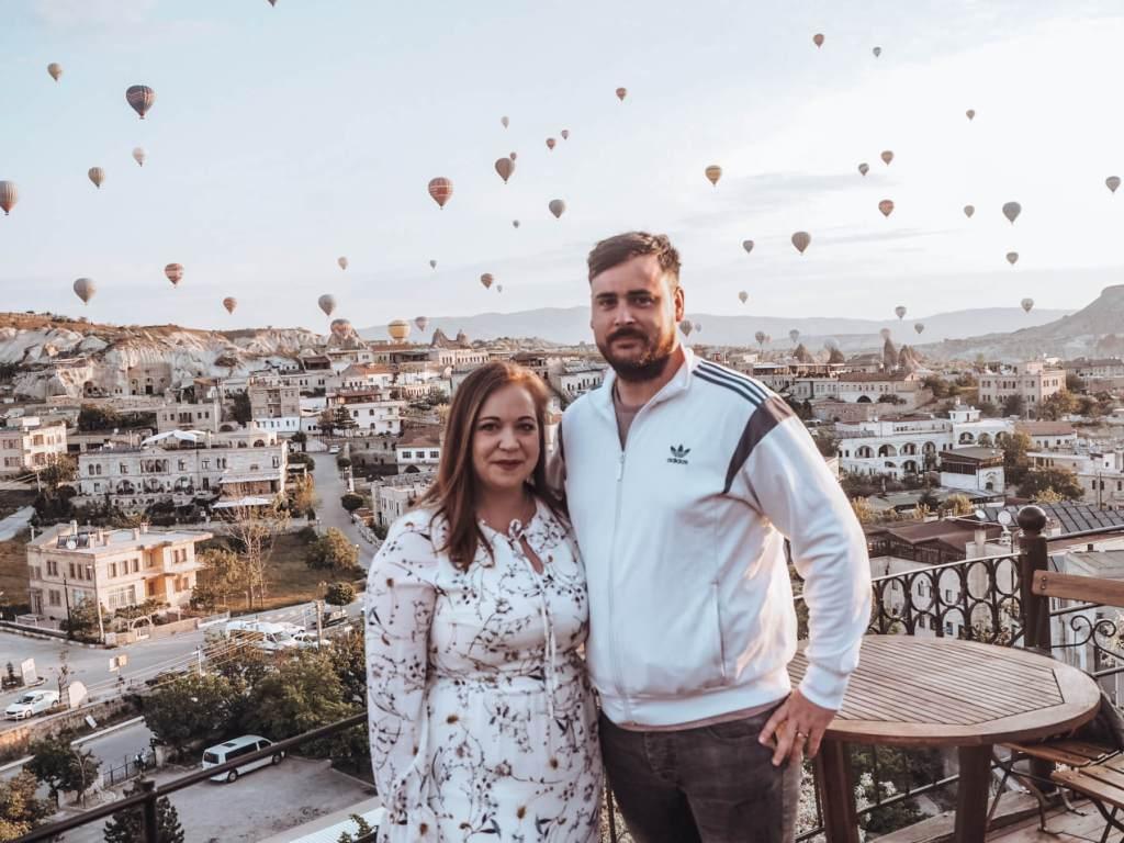 Couple watching the hot air balloons over Goreme Cappadocia.