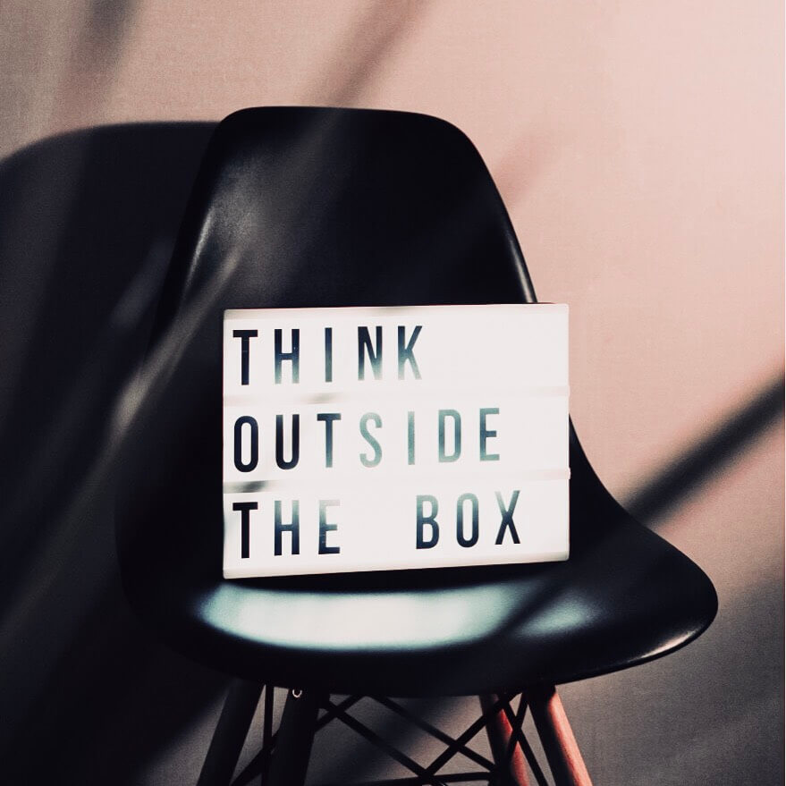Image of  a chair with a light box stating to think outside the box. A blog post on what to do if your Instagram accounts is hacked.