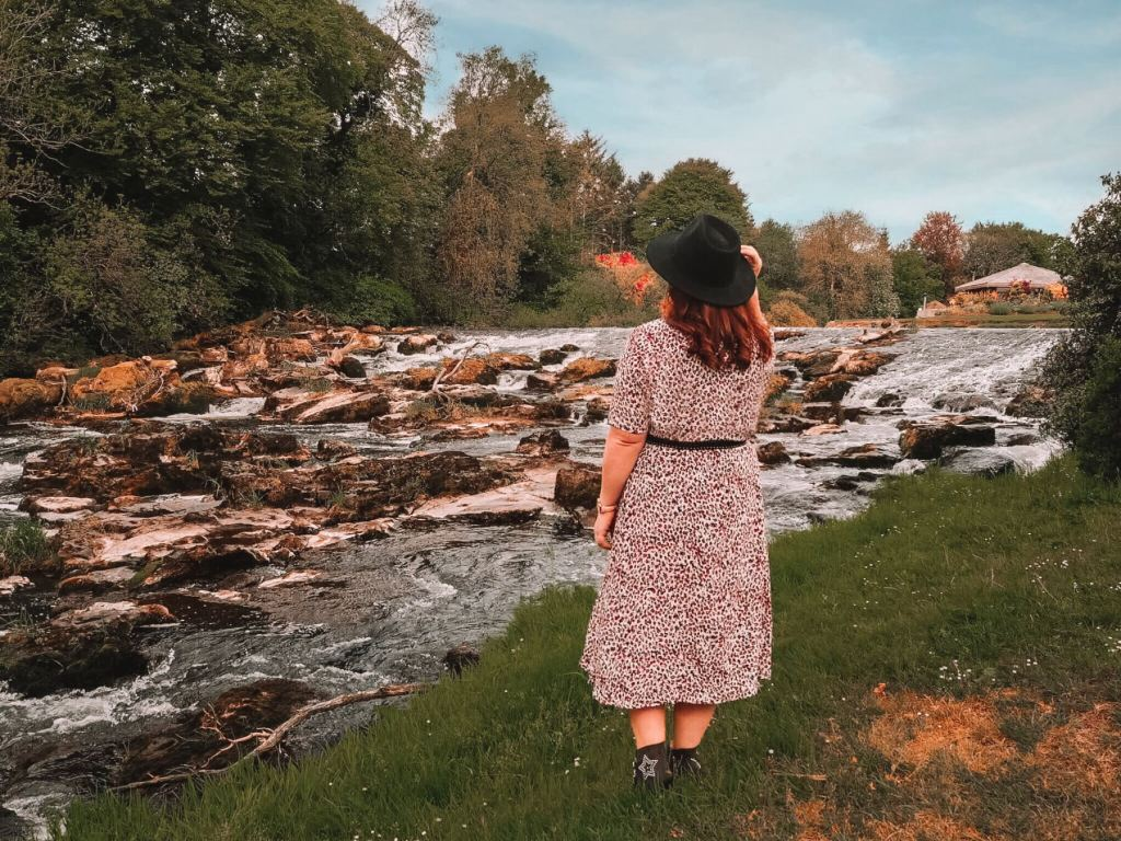 Girl looking at the River Maine in Northern Ireland
