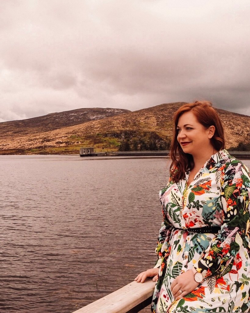 girl looking at a lake in northern ireland