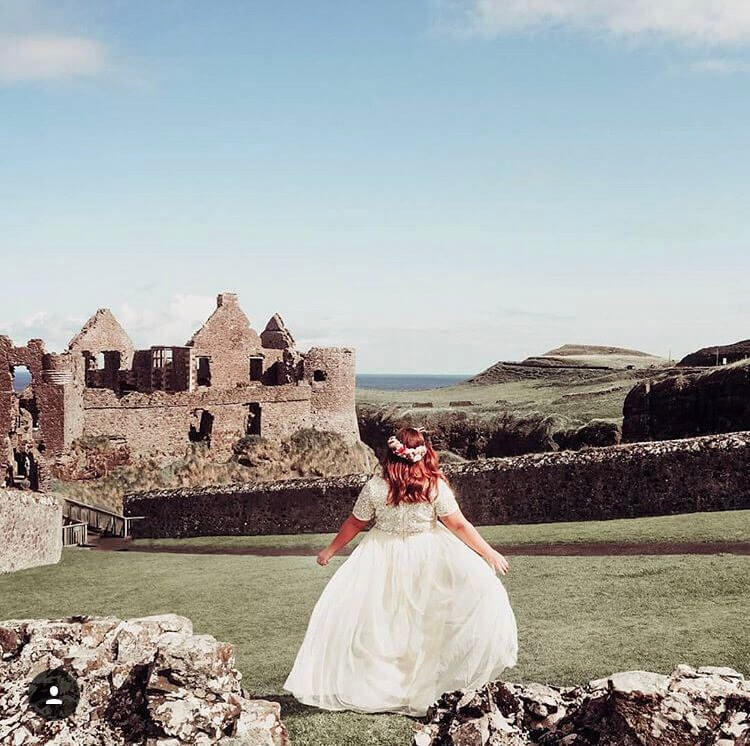 girl wearing dress at medieval castle