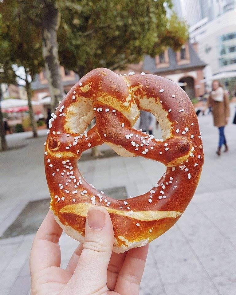Enjoying a pretzel in Frankfurt Germany