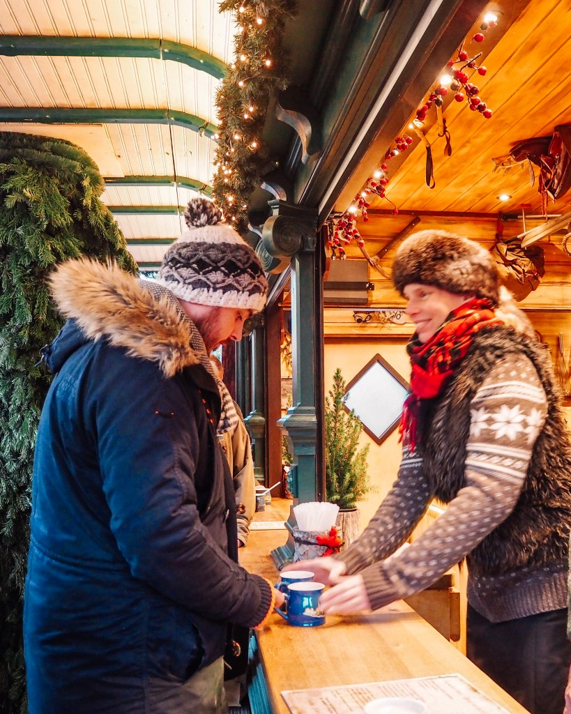 Buying mulled wine at the Hamburg Christmas Markets