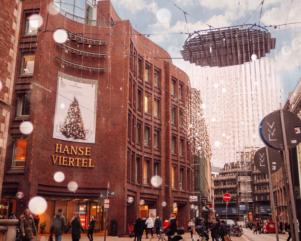 Busy shopping area decorated for Christmas at Passagenviertel Hamburg