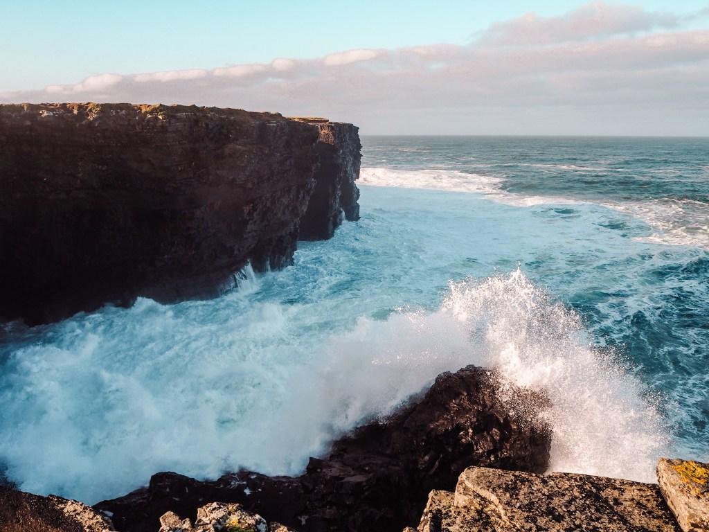Crashing waves of the Atlantic Ocean on The Wild Atlantic Way in Ireland.