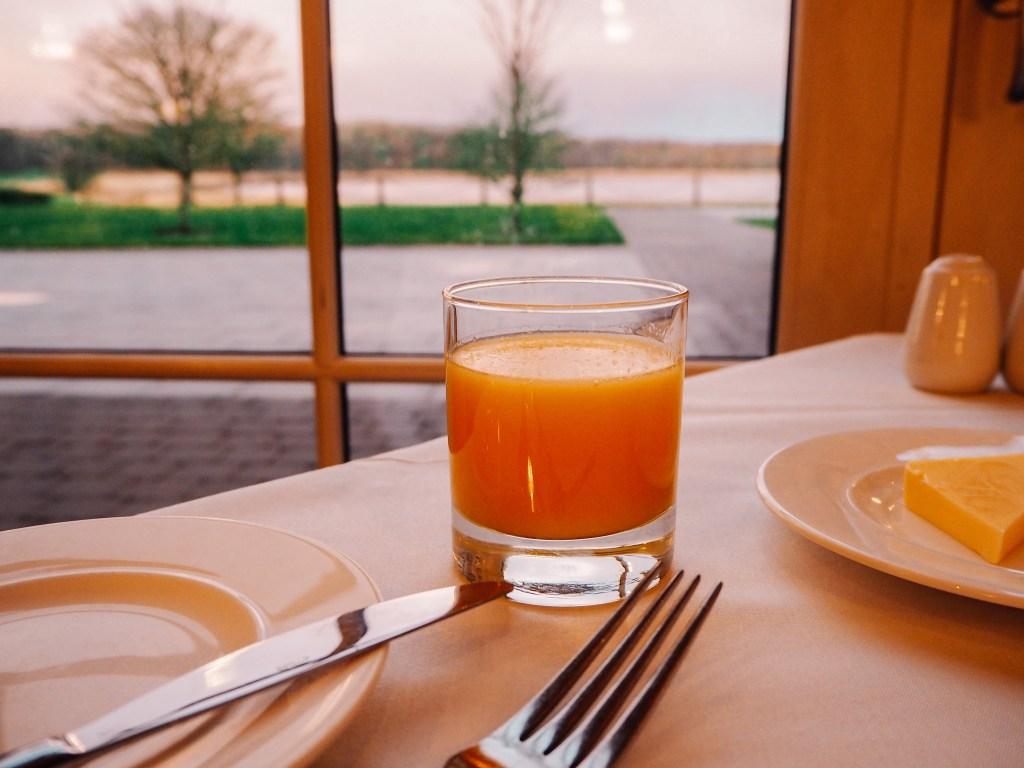 A glass of Orange Juice on a breakfast table