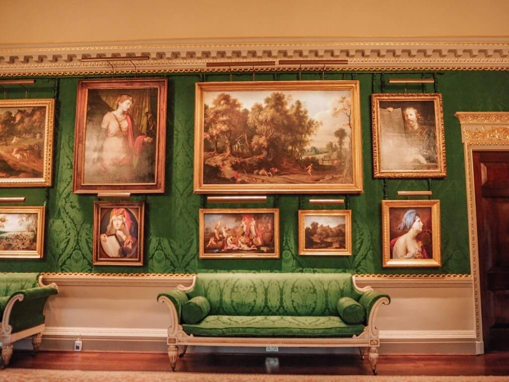 Oil paintings and a green couch at Hillsbourough Castle and Gardens