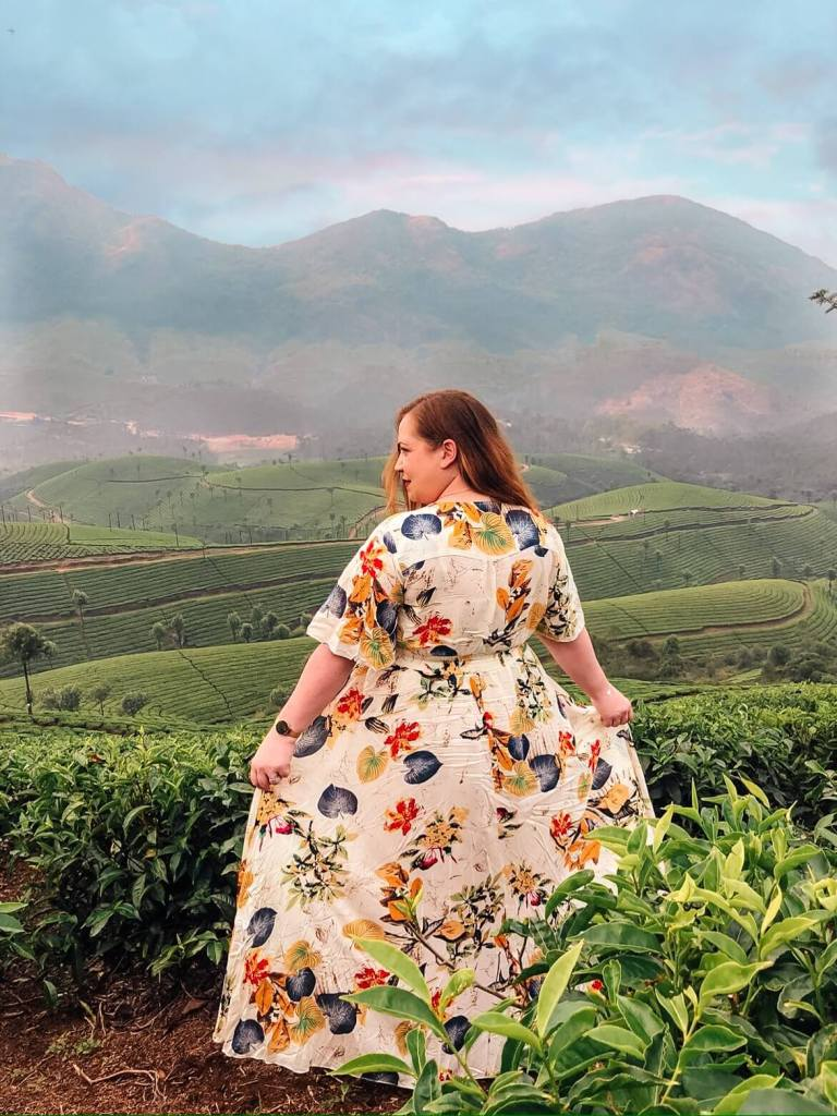 Woman standing among the tea plantations in Munnar on the Kerala Blog Express