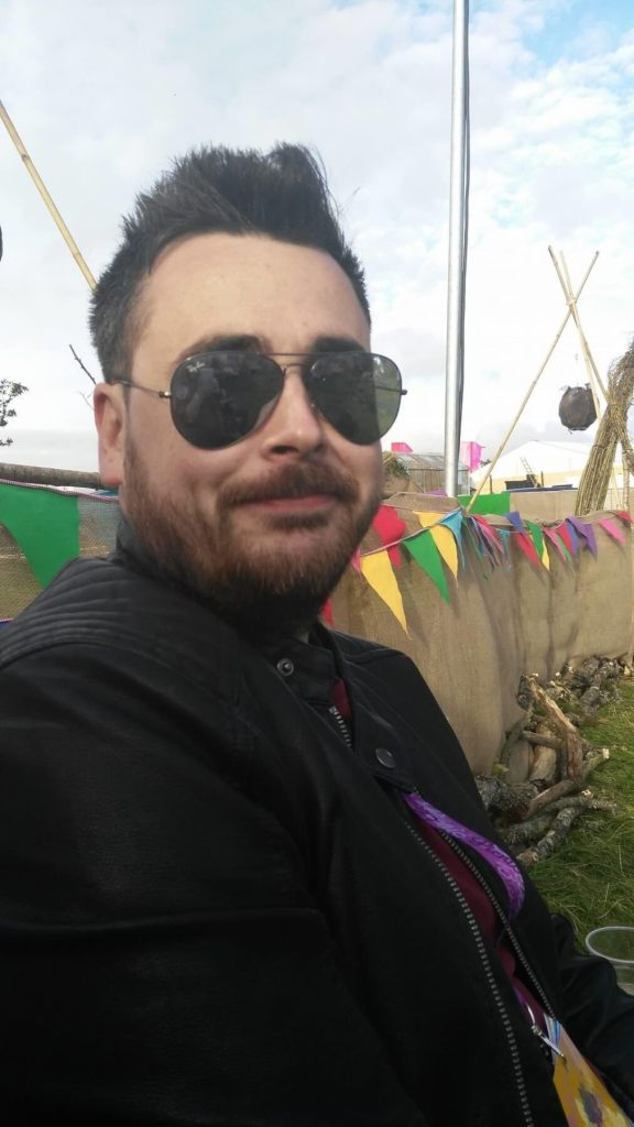 Man wearing a leather jacket and sunglasses at an Irish Music Festival