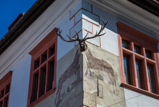 Details of tenement house called House with Stag in Sighisoara town in Romania