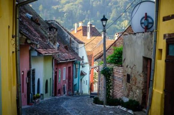Cobbled streets of Sighisoara Romania. Taking a walking tour is a top thing to do in Sighisoara