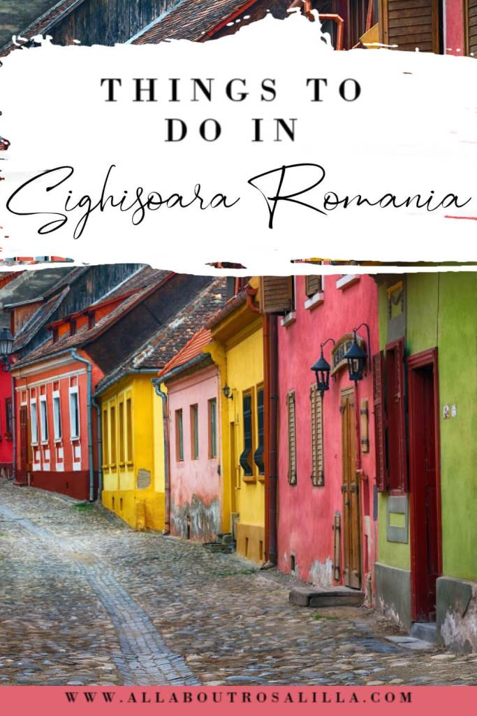 Image of the Romanian village of Sighisoara with text overlay things to do in Sighisoara