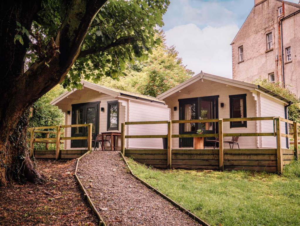 Cosy cabins at Dunmore House and Gardens at the base of the Inishowen peninsula in Donegal Ireland perfect for your staycation in Ireland.