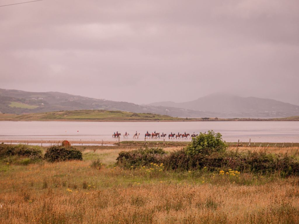 Horseriding on Portsalon Beach Donegal one of the many things to do in Donegal