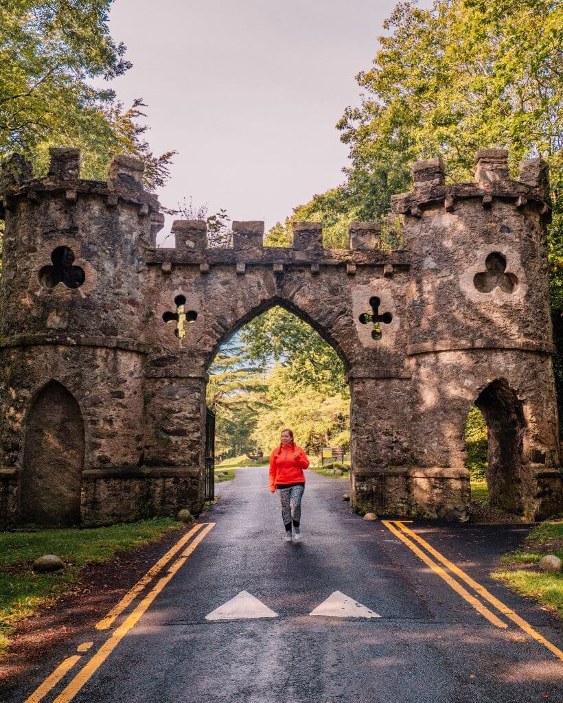 Woman walking at the entrance to Tollymore forest a game of thrones filming location in County Down Northern Ireland