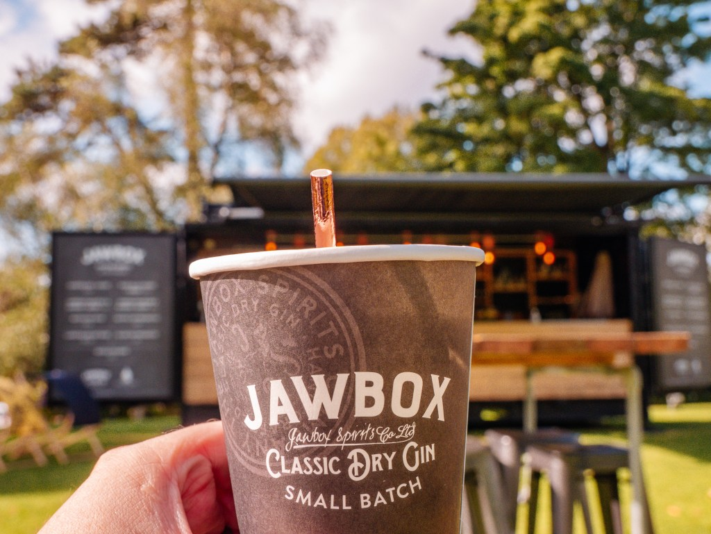 Man holding up a cup of Jawbox Gin
