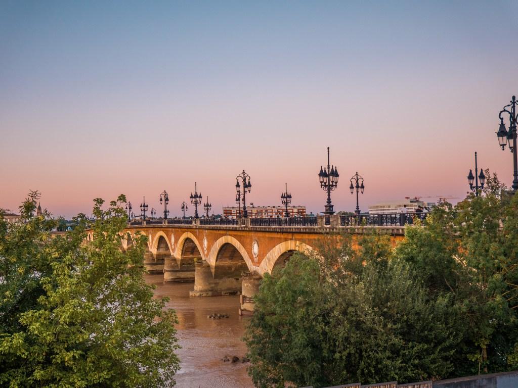 Pointe de Pierre bridge crossing the river Garonne, photographed at sunset