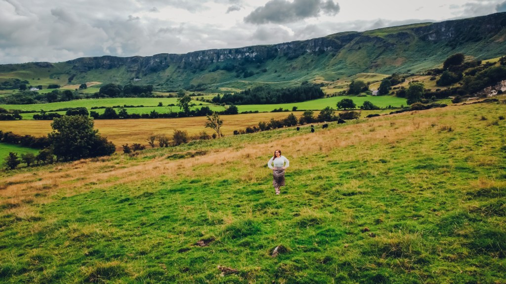 Woman standing at Sallagh Braes and Cairncastle a hidden gem in Antrim Northern Ireland