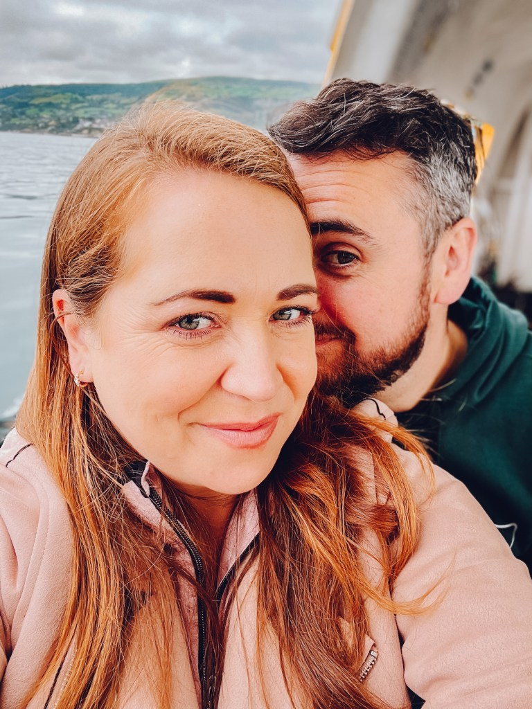 Couple on a boat at Carnlough Harbour Antrim