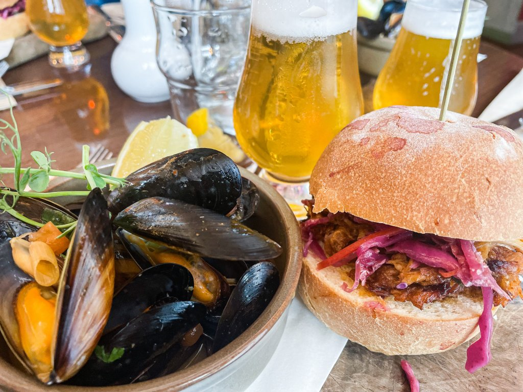 Plate of mussels and a pulled pork bap on a Galway food tour