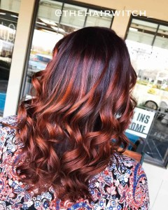 dark brown hair with copper highlights