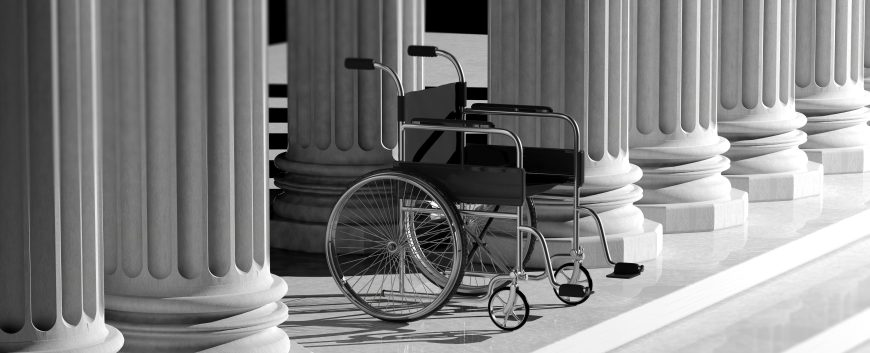 An empty wheelchair in front of steps.