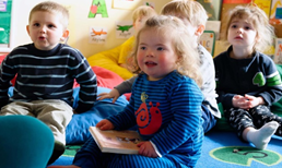 An image of children sitting at a daycare.