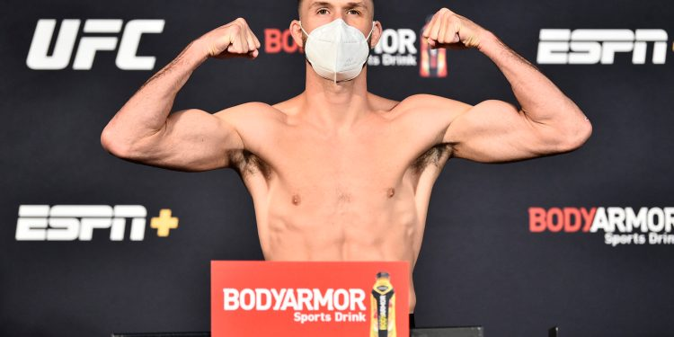 LAS VEGAS, NEVADA - JUNE 26: In this handout image provided by UFC, Julian Erosa poses on the scale during the UFC weigh-in at UFC APEX on June 26, 2020 in Las Vegas, Nevada. (Photo by Chris Unger/Zuffa LLC via Getty Images)