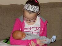 Tweedle Dee meeting her new cousin, Ryley.