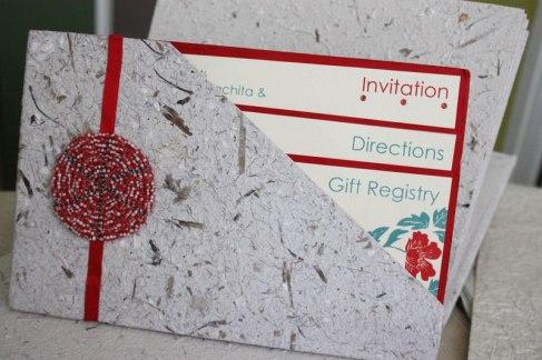 Custom made pocket invitation on hand made paper