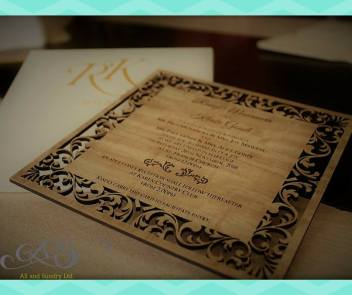 Laser engarved wooden invitation in a handmade box with kikoy wrap