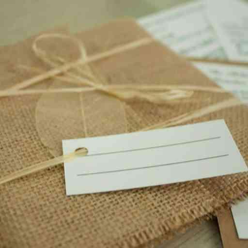 Rustic invitation with hessian wrap and raffia tie