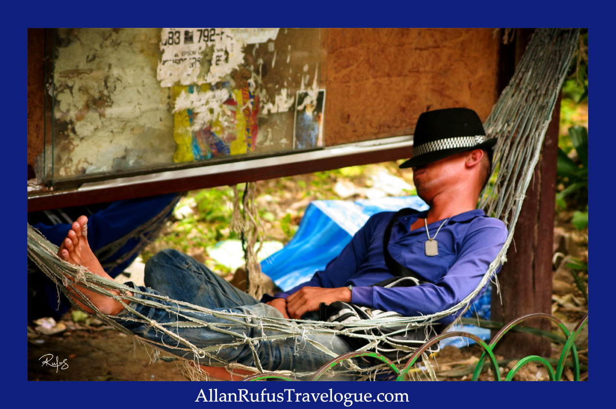 Street Photography A Man In A Hammock Sleeping And