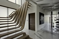 Staircase - the centerpiece of the apartments ...
