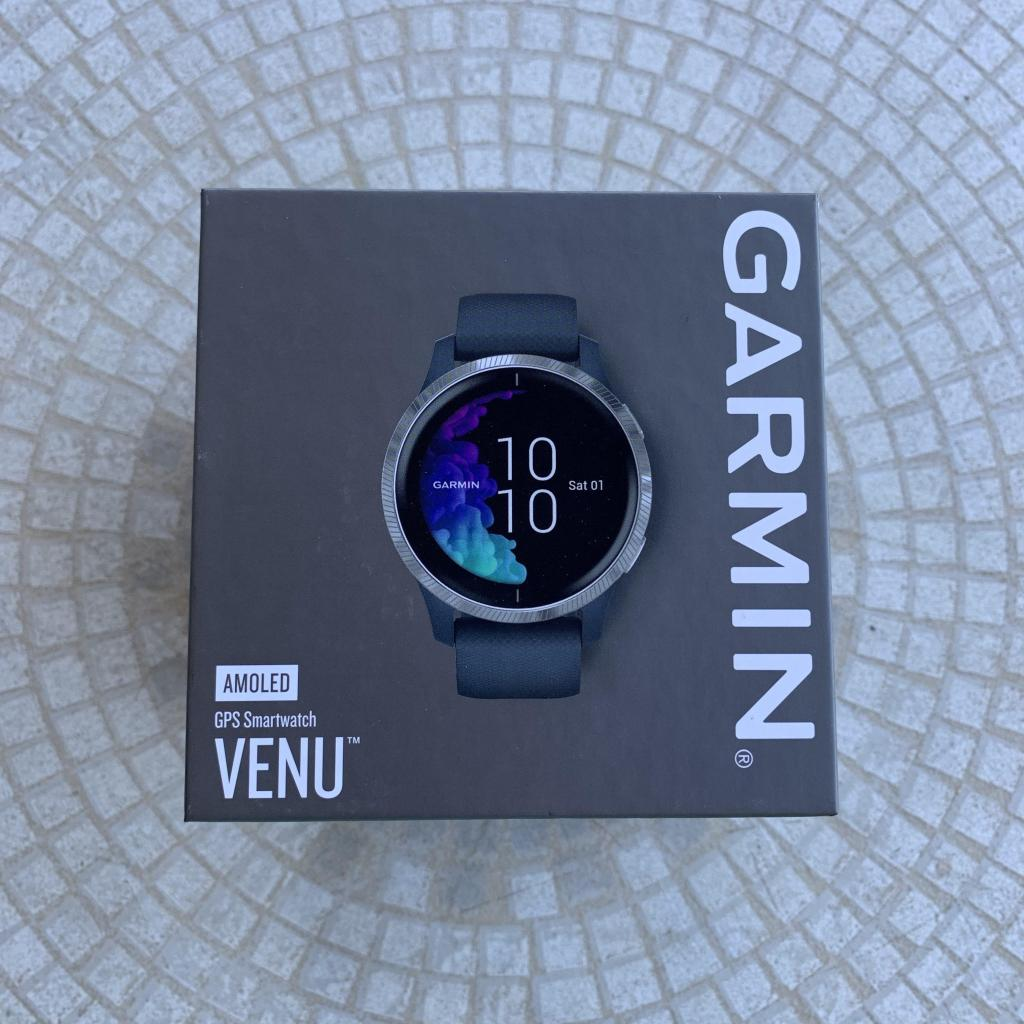 Garmin Venu in the box with tile table background