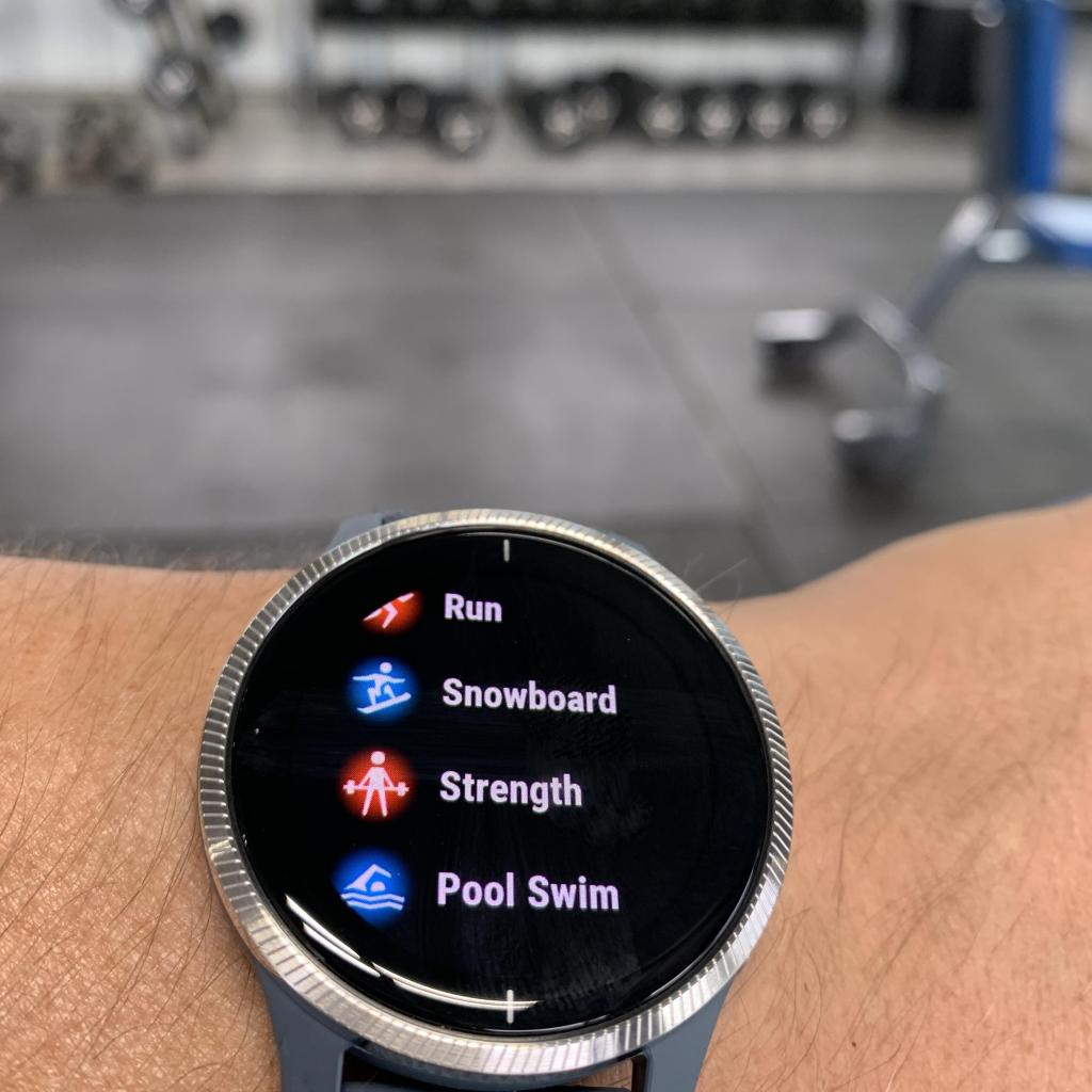 Garmin Venu in the gym showing off the strength activity