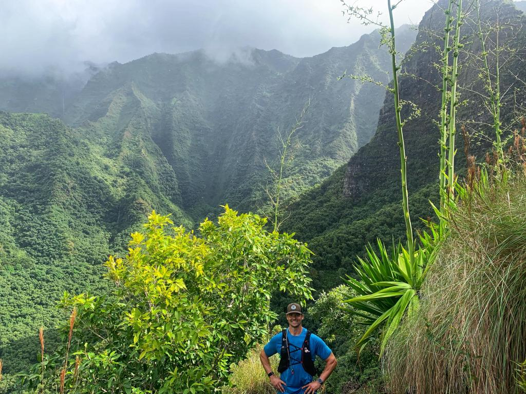 Joe with amazing green mountains of Napali Coast on the way back from a long day on the trail