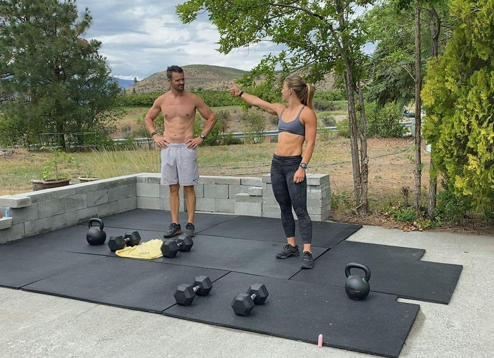 Emily giving Joe a thumbs up before an outdoor workout